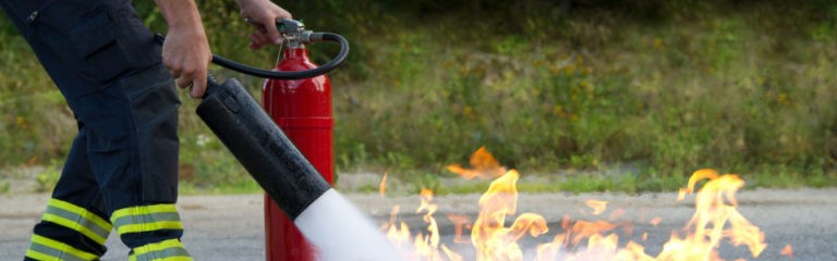 fire extinguisher being used to put out fire